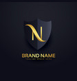 letter n logo in premium style with shield vector image