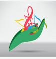 hand holds music note icon vector image