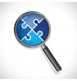 magnifying glass on a blue jigsaw vector image