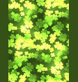 seamless festive texture with a happy four-leaf vector image