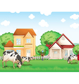 Three cows eating in front of the neighborhood vector image