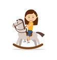 little girl riding a toy horse vector image