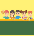 kids standing at the table with school supplies vector image