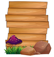 Wooden signboards with a mushroom and rocks at the vector image