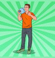 deliveryman holding water jug pop art vector image