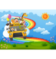 A zoo bus at the hilltop with a rainbow in the sky vector image
