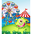A one-eyed green monster at the carnival in the vector image