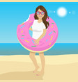young woman with inflatable donut float on beach vector image