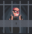 a picture of a thief in a mask in prison behind vector image
