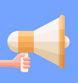 hand holding the megaphone icon vector image