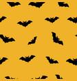 halloween bat fly seamless pattern vector image