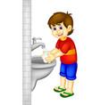 handsoome boy cartoon stading with hand wash vector image