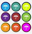 Umbrella icon sign Nine multi colored round vector image