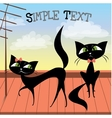 Lovely couple of black cats on the roof vector image