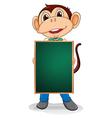 A monkey holding an empty blackboard vector image vector image
