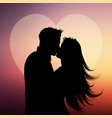 silhouette of couple kissing on a heart background vector image