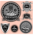 set of monochromatic emblems with mountain vector image