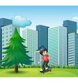 A boy skateboarding near the high buildings vector image vector image