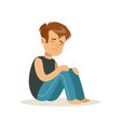 stressed boy character sitting on tha floor vector image
