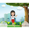 A pretty lady standing near the tree across the vector image vector image