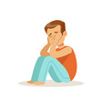 stressed crying boy character sitting on tha floor vector image vector image