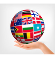 Flags of the world in globe and hand vector image