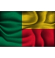 Crumpled flag of Benin on a light background vector image