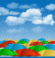 Colorful umbrellas in rain vector image