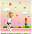 A girl playing at the field with candy balls vector image