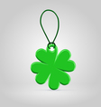 Green plastic shamrock leaf tag vector image