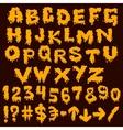 Yellow font smudges alphabet splashing vector image