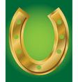 lucky horseshoe on green background vector image
