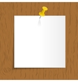 White reminder with pin on wooden background vector image