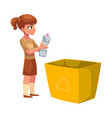 girl going to throw plastic bottle in a trash bin vector image