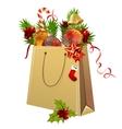 paper bag full of christmas balls vector image