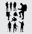 Male and female hiker silhouettes vector image