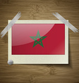 Flags Morocco at frame on wooden texture vector image
