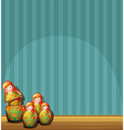 A blue wall with four Russian dolls vector image