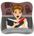 Afraid little boy reading horror book indoors vector image