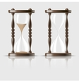Sand falling in the hourglass on dark background vector image