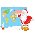 Santa Claus with a world map vector image vector image