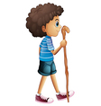 A young boy hiking vector image