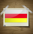 Flags North Ossetia at frame on wooden texture vector image