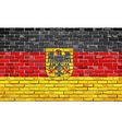 German flag with emblem on a brick wall vector image