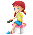 A girl holding a remote control vector image vector image