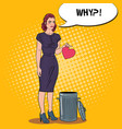unhappy woman throws her heart in the trash vector image