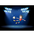 A young boy playing soccer with spotlights vector image