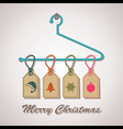 Christmas icon labels hanging on a hanger vector image