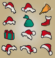 set of red santa hats and clothing and christmas vector image