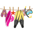 beach accessories hanging on a rope vector image
